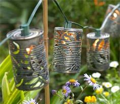 recycled soup cans become garden lights