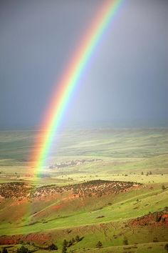 ✮ Vivid rainbow over the foothills of the Bighorn Mountains in Bighorn National Forest, Wyoming