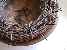 Homemade crown of thorns decoration/ this is great for everyone to reflect on Jesus while he was on the cross during Lent - grapevine wreath with nails - watch the kids near this decoration
