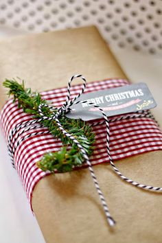 Brown paper – layer a fabric scrap over the middle and use baker's twine to tie on a tag – easy breezy.