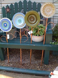 Thrift store plates have a new life as garden art! Also a tone of other ideas for garden art!!! garden plate, dinner plates, garden art, plate flower, yard art, garden paths, gardens, flower ideas, art flowers