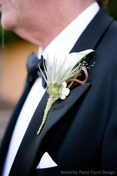 Calla lily and succulents give this boutonniere a masculine edge. Wedding Event Design and Flowers: Waterlily Pond Floral and Event Design   Wedding Photographer: Larissa Cleveland Photography