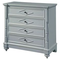 Four-drawer hall chest in cornflower blue with carved trim and raised diamond detail.