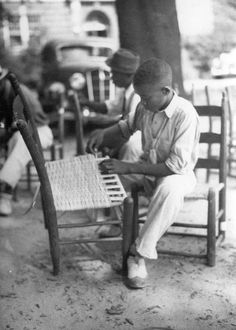 African-American boy weaves seat caning onto a chair, Guilford County, North Carolina, September 1937