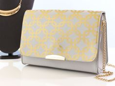 Use Iron-on and your Cricut Explore to up cycle a faux leather handbag. Photographer: Heather Price