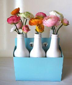 Spray painted soda bottle vases!