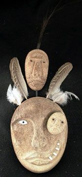 ALASKA: Eskimo   Mask, made from ossified whale bone, Whalewatcher, Shamanic with miniature mask in the eye of the major face, surmounted by another smaller face, with a long slender hair cluster extending above. D036 John Koshman
