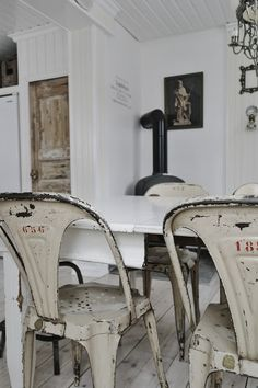 Love the numbered tolix chairs in a white dining room