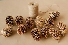 DIY gold leaf pine cone garland from The Sweetest Occasion | Photo by Alice G Patterson