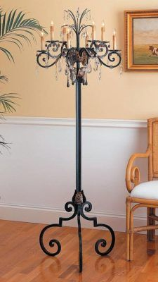 A dramatic room appointment contributes chandelier grandeur from the rug up. Antiquated candledrip bulb bases. 64 in. high.