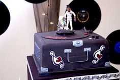 Music themed cake with Star Wars toppers. Read all about Julie & Johnny's Rainbow-Colored Rock and Roll Wedding on Poptastic Bride. Photos by Studio Sequoia.