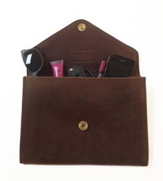 Tigist leather clutch by fashionABLE $78