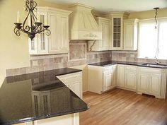 cupboard, floor, cabinet colors, kitchen backsplash, kitchen countertops, black kitchens, kitchen ideas, hood, kitchen cabinets