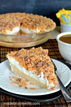 Peanut butter cheesecake topped with crushed Butterfinger pieces.  This is the pie you need in your life.