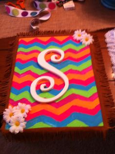 Rainbow chevron with white flowers/lettering  and fringe detailing
