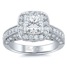 Princess cut halo engagement ring with tulip design.