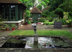 15th Century Manor House in West Sussex with formal garden and decorative pools