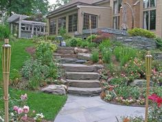 like the steps going down - thinking something like this or big boulders stepping down the slope in our backyard towards the back patio - don't need all the plants around - just grass