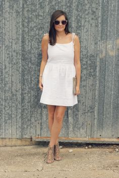 Blogger Love You Mean It looks summer-savvy in her white Gap dress.