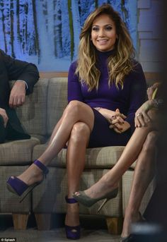 Jennifer Lopez crossed legs in a long-sleeve violet mini-dress and sky high heels on Good Morning America #legs #heels