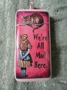 we're all mad here pendant. I think this would make a better keychain...