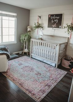 Love this boho nursery with shiplap accent wall
