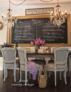 chalkboard, chandelier, chairs, table