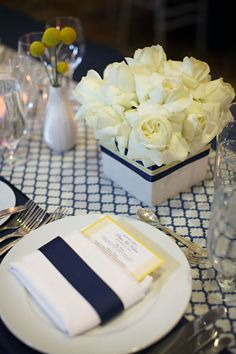 plate setting & center pieces. love the box of roses.