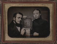 Daguerreotype of a couple in deep mourning. In their hands a daguerreotype of the mother with their four children. c. 1850.