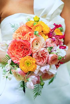 Bouquet of garden #roses, ranunculuses, sweet peas, gloriosa lilies, and ferns | Brides.com