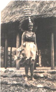 Samoa chief's daughter (taupo) with necklace and traditional head dress c1920