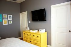 Bedroom wall.Grey with yellow furniture (repaint the antique dresser and nightstands?)