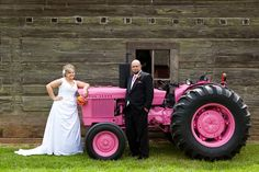 I have never seen a pink John Deere tractor!  Love!