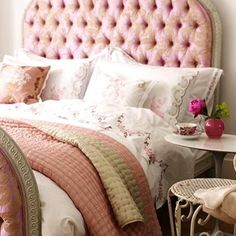 Pink tufted bed