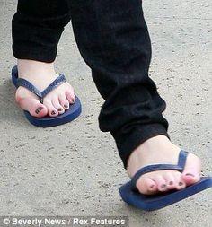 You've got bunions, hun! Wearing flip flops, Christina Hendrick's swollen, red feet are laid bare