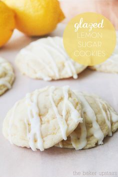 Glazed lemon sugar cookies from The Baker Upstairs. These cookies have the perfect soft texture and are delicious sweet with just a hint of tartness! www.thebakerupstairs.com