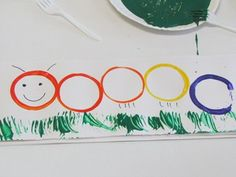 Caterpillar art with cups and forks