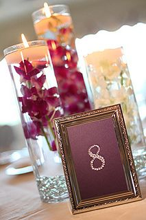 rhinestone table numbers and orchid centerpieces