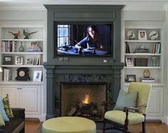 Love dark fireplace with white bookcases!