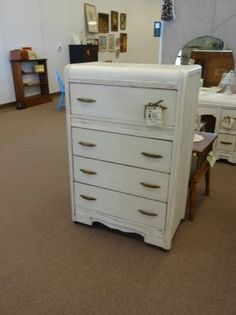 SOLD - Waterfall style dresser painted creamy white, antique and distressed 4 drawers. ***** In Booth B8 at Main Street Antique Mall 7260 E Main St (east of Power RD on MAIN STREET) Mesa Az 85207 **** Open 7 days a week 10:00AM-5:30PM **** Call for more information 480 924 1122 **** We Accept cash, debit, VISA, MasterCard or Discover.