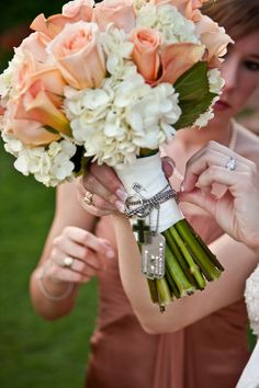 What a great idea Sarah...In memory of my Grandpa, we wrapped his dogtags around my wedding boquet (military bouquet)