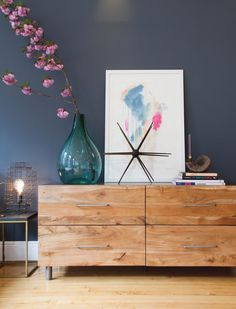 Wooden dresser drawers with metallic legs and hardware.  Seen in Athena Calderone's Pinterest-Designed Bedroom   Lonny
