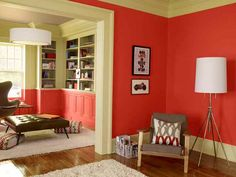 Daring red makes a smooth transition from the walls of one room to the wainscoting of the next.
