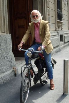 To be sooo cool at his age. Snappy dresser, riding an old bicycle in Europe somewhere.