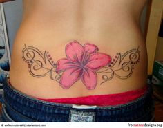 Hibiscus tattoo on a girl's lower back