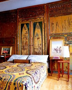 Giambattista Valli Rome. 19thC Indonesian carved-wood doors act as a headboard in the bedroom - ELLE DECOR