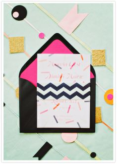 pink and black confetti invitation