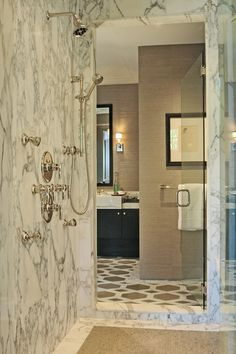 Beautiful shower and Studio Moderne floor from Walker Zanger.