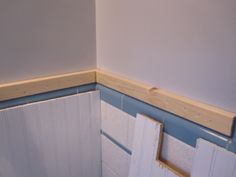 white beadboard applied directly over tile. my pink bathroom is screaming for this makeover.