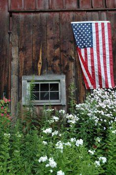 Rustic barn and flag